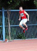 Максимчук Иван настроен для участвовать в гонке 200 метров — Стоковое фото