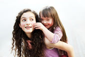 Happy little girl with sister — Stock Photo