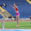 Biruk Tamara wins high jump under the rain on Ukrainian Track & Field Championships on June 01, 2012 in Yalta, Ukraine — Stock Photo