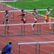 Foto de Stock  : Women at hurdles race on UkrainiTrack & Field Championships on June 01, 2012 in Yalta, Ukraine.