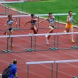 Foto Stock: Women at hurdles race on UkrainiTrack & Field Championships on June 01, 2012 in Yalta, Ukraine.