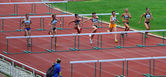 Women at the hurdles race on Ukrainian Track & Field Championships on June 01, 2012 in Yalta, Ukraine. — Stock Photo