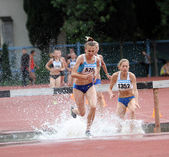 Girls compete in the 3.000 Meter Steeplechase on Ukrainian Track & Field Championships on June 01, 2012 in Yalta, Ukraine — Stock Photo