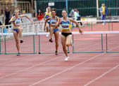 Slusarenko Katerina, Lebed Anastasia, Kolesnichenko Olena compete in the 400 meters race on Ukrainian Track & Field Championships on June 01, 2012 in Yalta, Ukraine — Stock Photo
