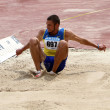 Kozlov Kirilo wins triple jump on Ukrainian Track & Field Championships on June 01, 2012 in Yalta, Ukraine. — Stock Photo