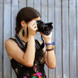 Girl takes pictures — Stock Photo