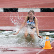 Girl compete in the 3.000 Meter Steeplechase — Stock Photo