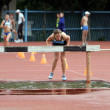 Stock Photo: Girls compete in 3.000 Meter Steeplechase