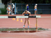 Girls compete in the 3.000 Meter Steeplechase — Stock Photo
