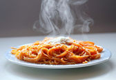 Italian spaghetti steaming with parmesan cheese. — Stock Photo