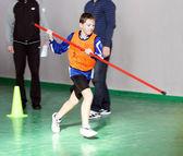 Pojke på barn friidrott tävlingen — Stockfoto