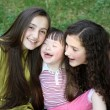 Happy little girl with sisters - Stock Photo