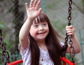 Portrait of beautiful young girl on the playground — Stock Photo