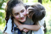 Portrait of beautiful young girls in the park — Stock Photo