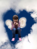 Little girl in the sky — Stock Photo