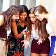 Stock Photo: Beautiful student girls during phone call