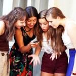 Beautiful student girls during phone call — Stock Photo #22559641