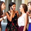 Beautiful student girls during phone call — Stock Photo #22560117