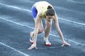 Beautiful teenage sport girl on the stadium — Stock Photo