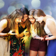 Beautiful student girls looking message on mobile phone — Stock Photo