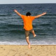 Boy running to the sea on summer holidays — Stock Photo