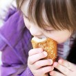 Portrait of beautiful girl that eating baguette — Stock Photo
