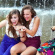 Beautiful girls having fun with a fountain. — Stok fotoğraf