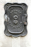 An old iron plate on a wall in Paris. — Stock Photo