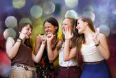 Teenage girls having fun at the party — Stock Photo