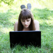 Beauty girl with laptop outdoors — Stock Photo