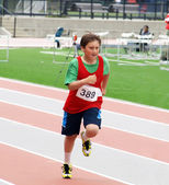 Boy on track and field competition — Stock Photo