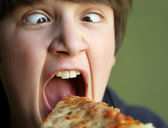 Funny Boy Eating Pizza — Stock Photo