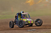Class 8 autograss car at speed — Stock Photo