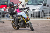 Motorcycle stunt rider team — Stock Photo