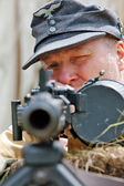 German army reenactor and machine gun — Stock Photo