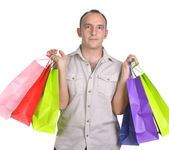 Man met verschillende shopping tassen — Stockfoto