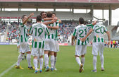 CORDOBA, SPAIN - SEPTEMBER 29: Cordoba players celebrating goal during match league Cordoba (W) vs Girona (B)(2-0) at the Municipal Stadium of the Archangel on September 29, 2013 in Cordoba Spain — Stock Photo
