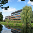 Modern riverside office block — Stock Photo
