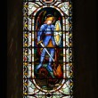 Stained Glass Window in Norwich Cathedral - Stock Photo
