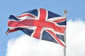 Unión bandera ondeando en la brisa — Foto de Stock