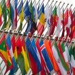 Stock Photo: Large number of national flags flying