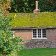 Stock Photo: English brick cottage with moss