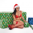 Sexy santa with gifts — Stock Photo
