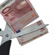Euro being cut in two by Scissors — Stock Photo