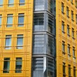 Stock Photo: Corner of bright yellow building