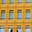 Foto Stock: Modern yellow Building and windows