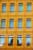 Modern yellow Building and windows — Stock Photo