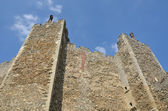 Looking upward to castle walls — Stock Photo