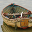 Stock Photo: Old Dingy with ropes
