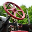 Stock Photo: Steering wheel of traction engine